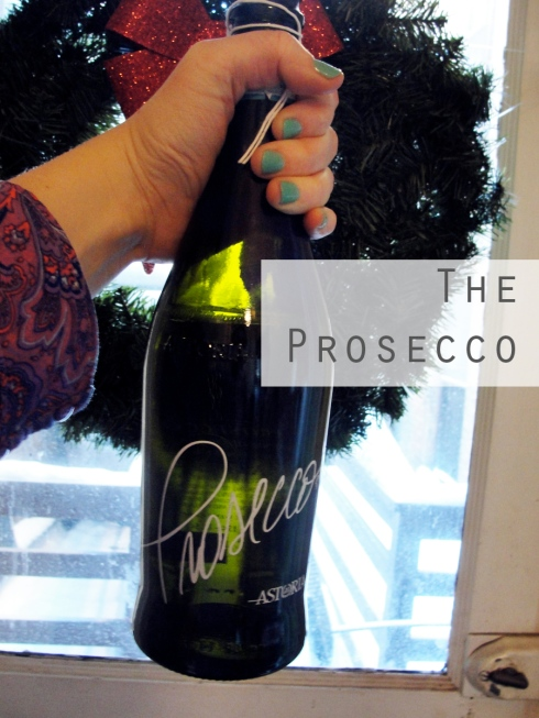 Astoria Prosecco holding bottle